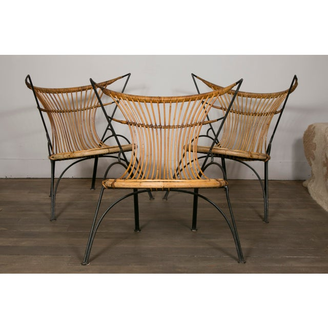 Set of 3 slipper chairs Black lacquered metal structure and woven wicker. France, circa 1950. Height : 29.52 in. (75 cm)...