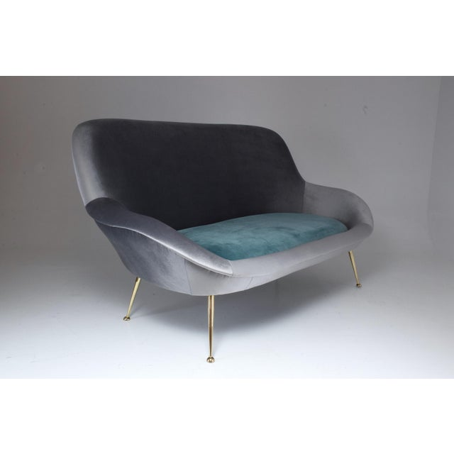 A rare 20th century Italian sofa manufactured by ISA Bergamo and designed in an organic curved shape with a cushioned...