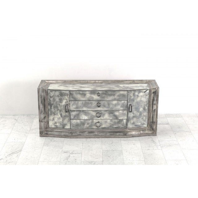 This glittering Hollywood Regency breakfront sideboard by James Mont features a smoked mirror top and front set inside a...