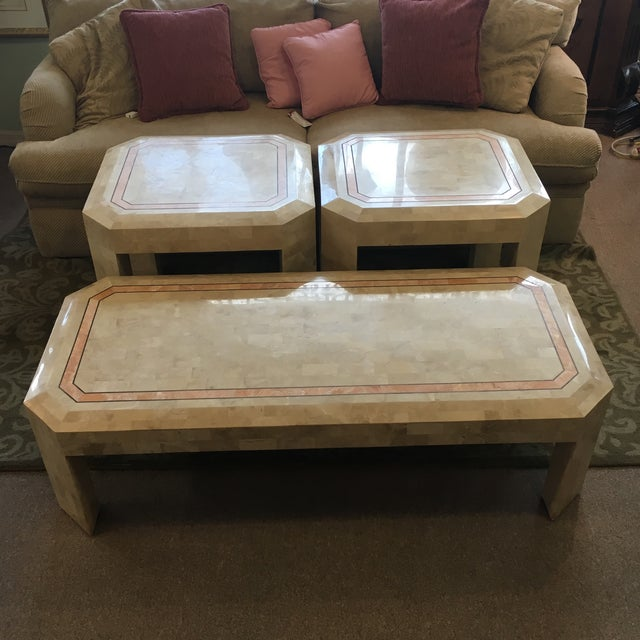 Stunning Maitland-Smith style three piece set. Includes one cocktail table with two end tables. Tessellated fossilized...