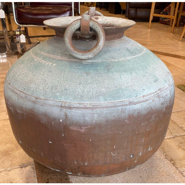 Large, antique, copper water jar from India. This large pot was made from two pieces of copper or brass joined about 3/4...