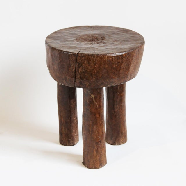 A Baule carved wood tribal stool from Ivory Coast.