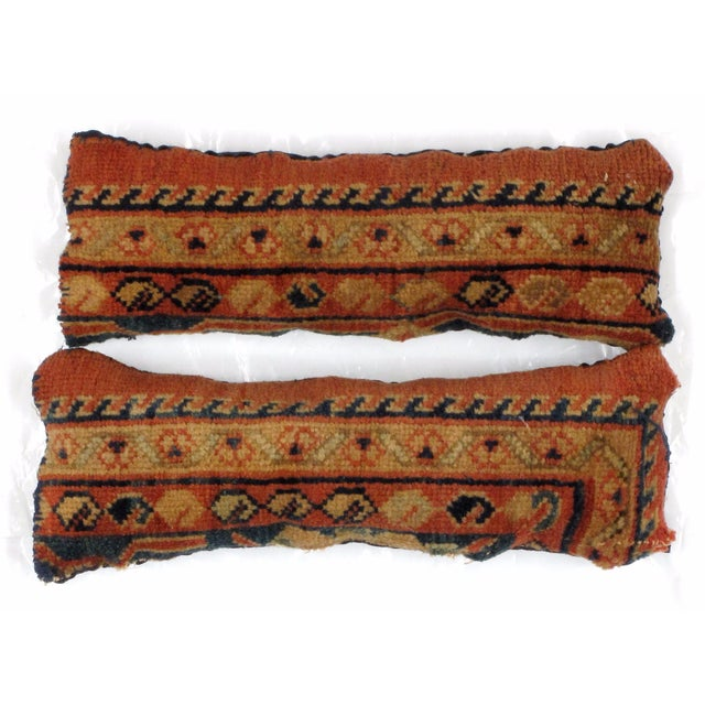 Pair of pillows with hand made antique Persian rug fragments. Poly fill ,fabric backing with sewn closure.