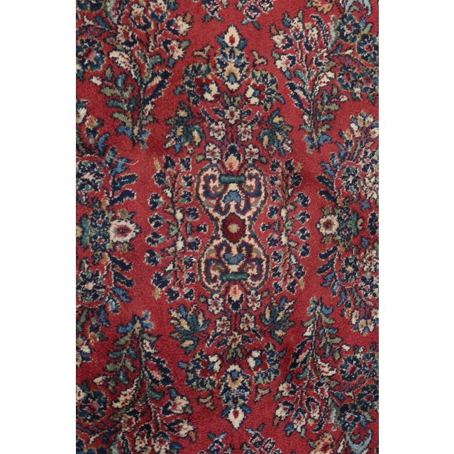 Item: F32103EC: KARASTAN Pattern 785 Sarouk Approx 11 x 20 Rug Age: Approx. 35 Years Old Details: Grade 6.5 Out Of 10...
