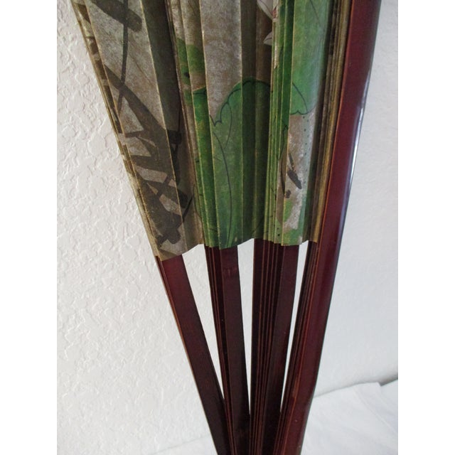 Beautiful large Japanese paper and lacquered wood hanging wall fan with a hand-painted botanical motif of flora and birds...