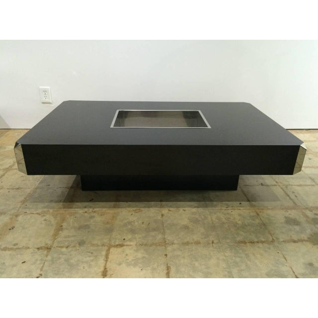 Black laminate and polished steel coffee, cocktail table with inset polished steel dry bar, planter and polished steel...