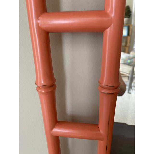 A wonderfully decorative accent piece to enhance any room. Orange. 27.5 wide x 40.5 high x 1.5 deep. Double bamboo frame.