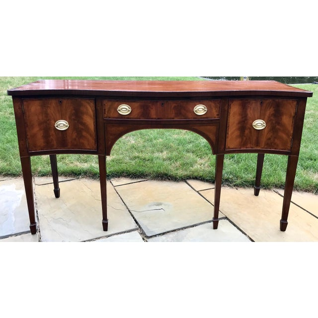 George III period English serpentine front sideboard with beautifully bookmatched crotch grain Mahogany veneered front...