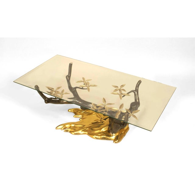 "Belgian Post War design (1970s) coffee table with a bronze ""Tree"" form base having brass patinaed leaves under a..."