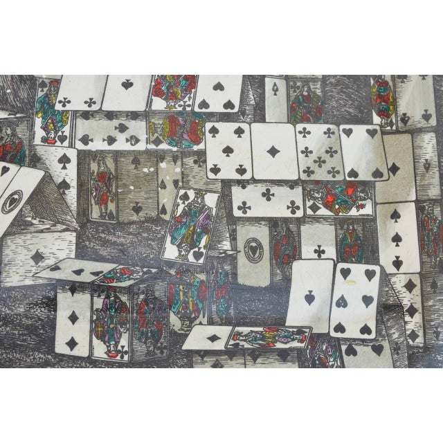 Lithographic printed metal tray in the 'City of Cards' pattern designed by Piero Fornasetti. Manufactured by Atelier...