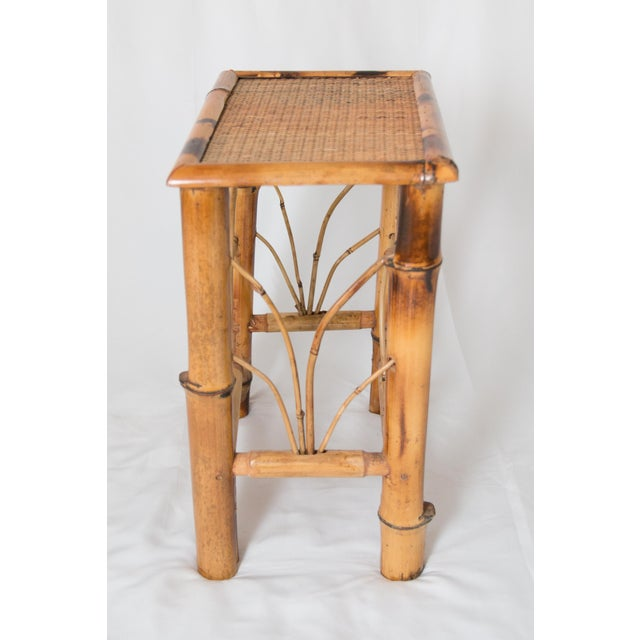 A charming vintage small bamboo side table. This would be a perfect addition to any room!