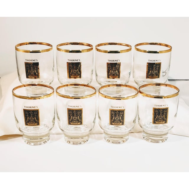 Vintage Thorne Scotch Whiskey Glasses. Classic set of clear glass with rolled gold emblem of Thorne logo on the front....