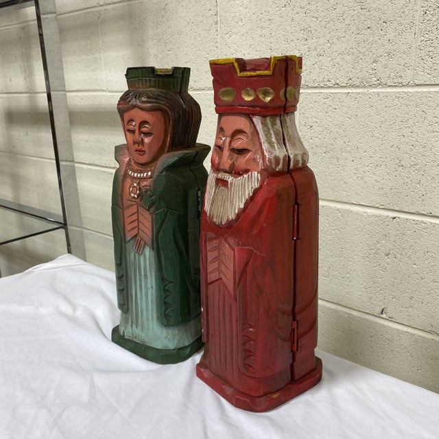Super cute king and queen carved wood wine bottle tote or holder. Solid wood, hinged with little hooks on side. Color is...