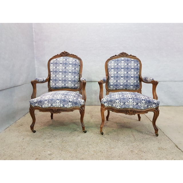 French Gorgeous Pair of French Newly Upholstered Carved Walnut Louis XV Caster Wheel Armchairs For Sale - Image 3 of 13