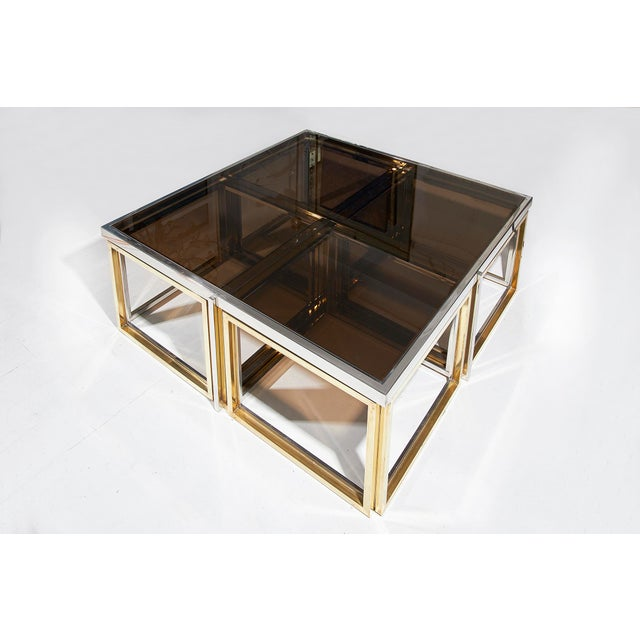 Maison Charles, Paris, large brass and chrome square coffee table with smoked glass top, four nesting tables beneath also...