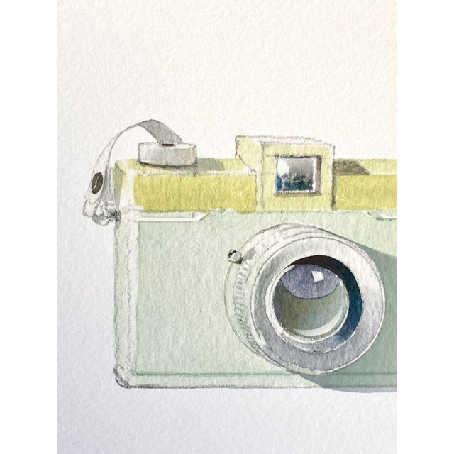 Inspired by the celadon green color and retro, mid-century camera design, this art print resonates with photographers and...