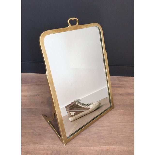 An interesting brass mirror made for a shoe store, French, circa 1900 This piece is currently in France, please allow 2 to...