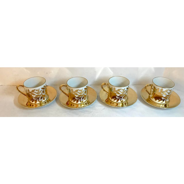 """Pretty Hollywood Regency style demitasse service for four. Beautiful gold floral design on white. Cups measure 3"""" x 2.25""""..."""