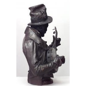 American Victorian style (late 19th Cent) metal bust of black banjo player wearing top hat with flowers on oval base (signed P. CALVI) For Sale In New York - Image 6 of 9