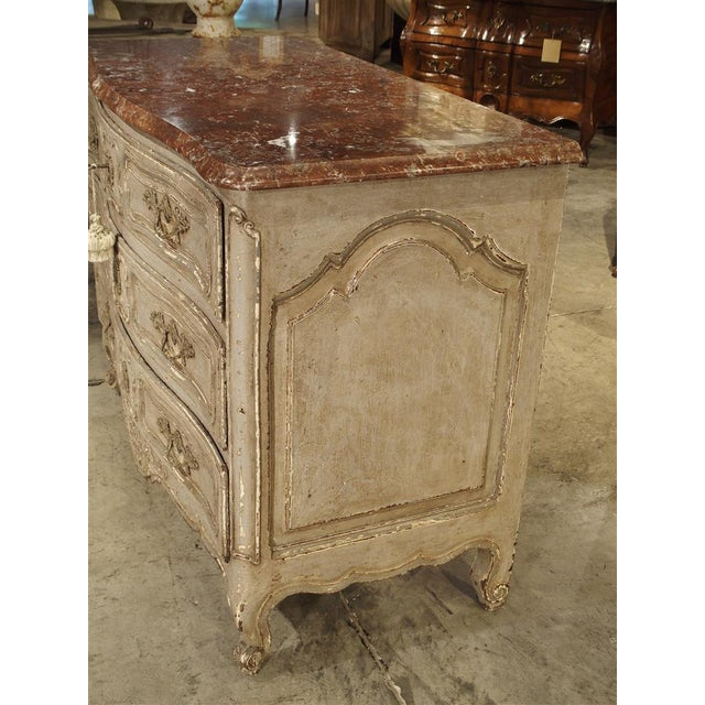 This is a wonderful antique French commode with a parcel paint finish from Provence, dating to the end of the 1800s. It...