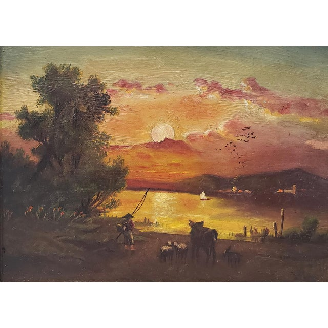 19th Century Luminous Sunset Over Mountain Lake Oil Painting Wonderful antique oil painting of a rich golden sunset over a...