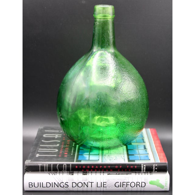 This is a stellar French Green Demijohn. Has a lovely glossy uneven texture, with some parts smooth and some orange peel....