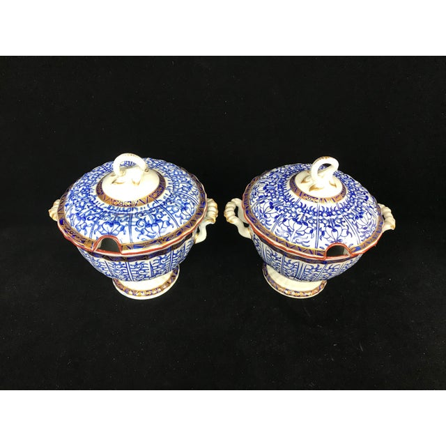 Matching pair of Victorian Era lidded sauce serving dishes, in blue, white and gold. Unmarked but good quality work dating...
