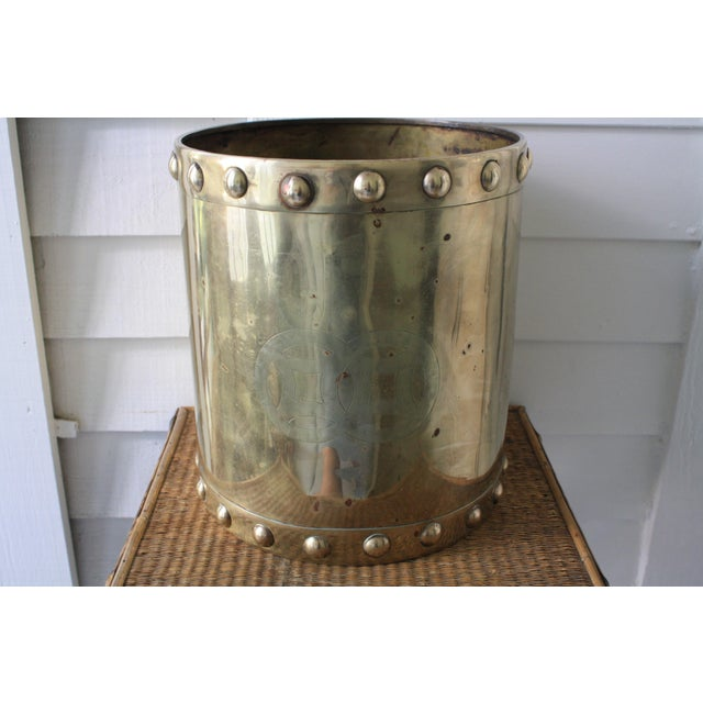 This is a large brass planter from the mid 20th century. The fabulously rustic Asian-inspired pot is trimmed with studs...