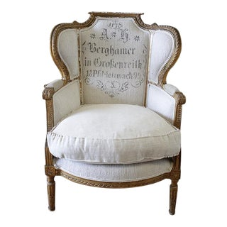 Antique French Louis XVI Style Wing Chair in Antique Grain Sack Upholstery For Sale