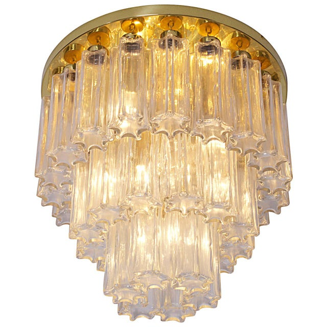 Limburg Murano clear beige glass flush mount chandelier. Venini Murano glass pendants, each with brass fittings. Brass...