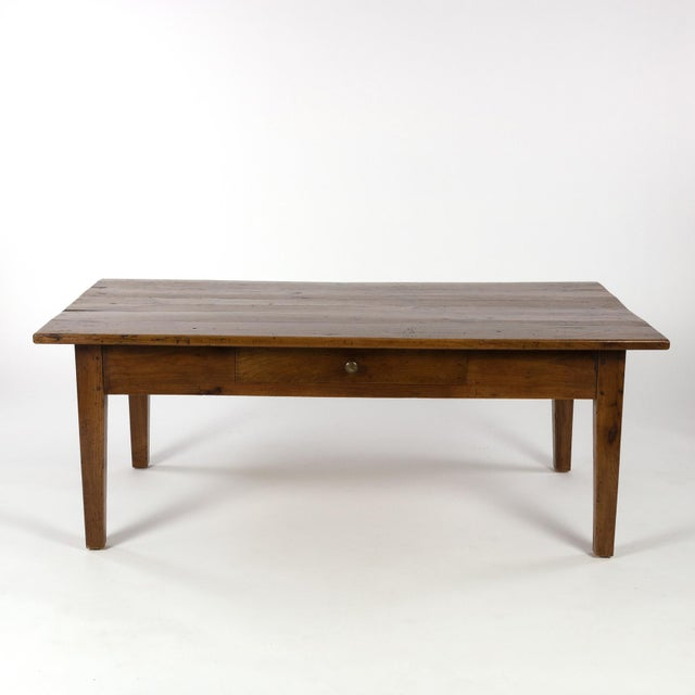 A French walnut low table with center drawer, circa 1870 with plank top and substantial tapering legs. height: 20 in. 51...