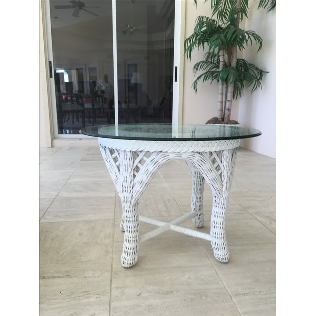 A pair of outdoor white wicker end tables by Woodard. Timeless outdoor wicker furniture.