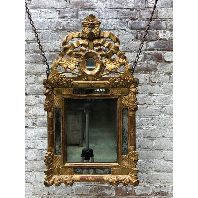 Louis XVI, carved gilt wood mirror, Provenance France This mirror is adorned with floral and foliate patterns. All in the...