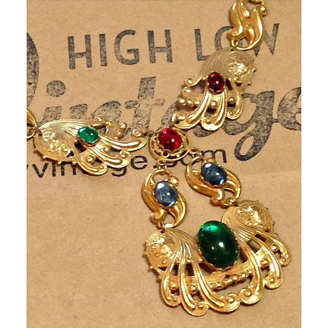 Beautiful necklace from the early 1950s by Miriam Haskell. Gold swirl design...multi color glass stones...the Haskell mark...
