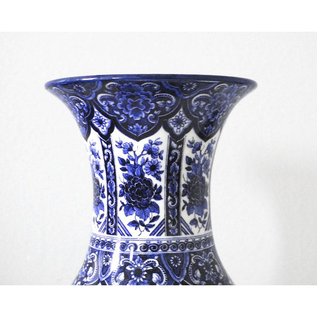 Lovely and tall vintage blue and white porcelain vase, made in Italy in about the 1960s. The vase has a detailed design...