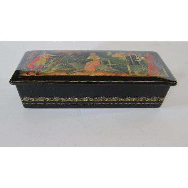 Black lacquer box w/red lacquer interior signed and dated '1987' by the Russian artist on the top in the bottom right...