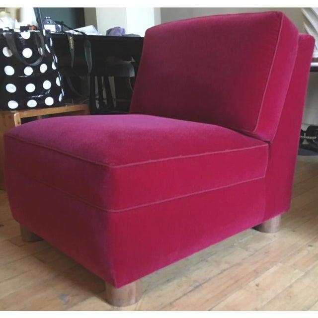 Jean Royere pair of slipper chair covered in red mohair velvet.