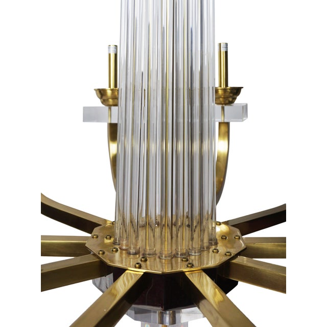 Stunning Warhol Chandelier by Modern History. The large chandelier features bent square brass arms adorned with Lucite and...
