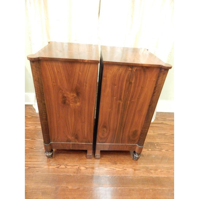 A beautiful pair of Charles X bedside cabinets with drawers. Very nice matching veneers on all sides. In excellent condition.