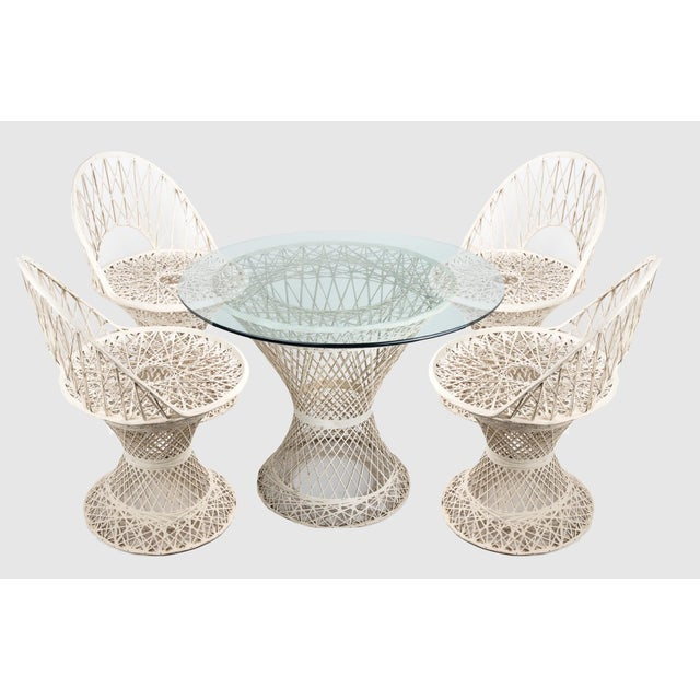 Iconic white spun fiberglass patio dining set designed by Russel Woodard, circa 1960. Great for indoors, too! Set...