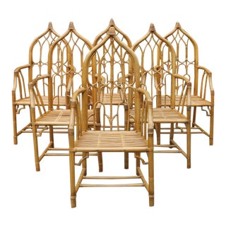 1970s McGuire Rattan Bamboo Gothic Cathedral Chairs All Arm Chairs - Set of 6 For Sale