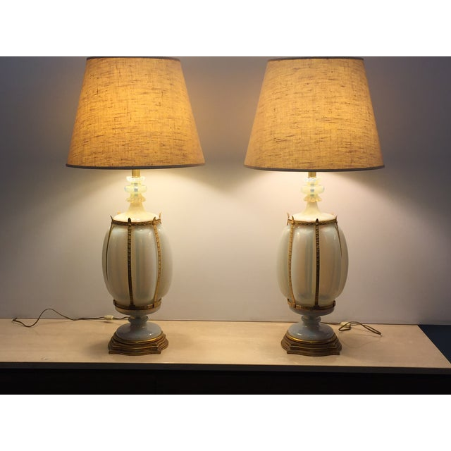 Beautiful pair of Marbro Lamps with gilt caged opaline Murano glass attributed to Seguso. Lovely condition no damage. Gilt...