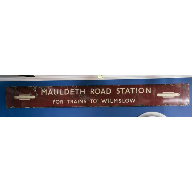Vintage porcelain enameled, painted sign from the Mauldeth railway station which opened in 1909. This station serves the...