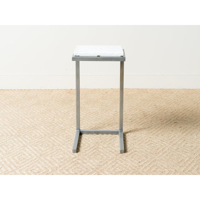 This side table has a zinc-plated steel frame. White stone top. Great for outdoor or indoor use. Made in the style of mid-...