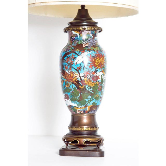 A lovely Japanese cloisonne vase in vivid colors of blue, red, yellow, green and lilac. Overall decorations of brown...