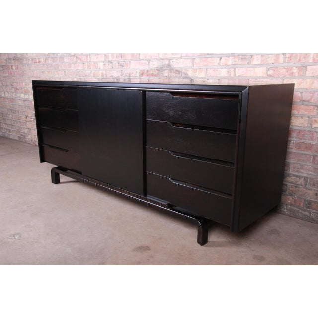 An exceptional mid-century Swedish Modern ebonized birch sideboard credenza or bar cabinet By Edmond Spence Sweden, 1950s...