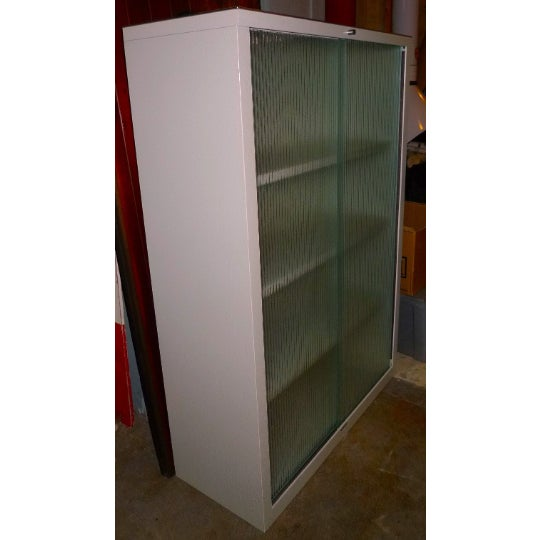 """Mid-century Steelcase storage cabinet with sliding ribbed-glass doors. Excellent, """"like new"""", vintage condition inside and..."""
