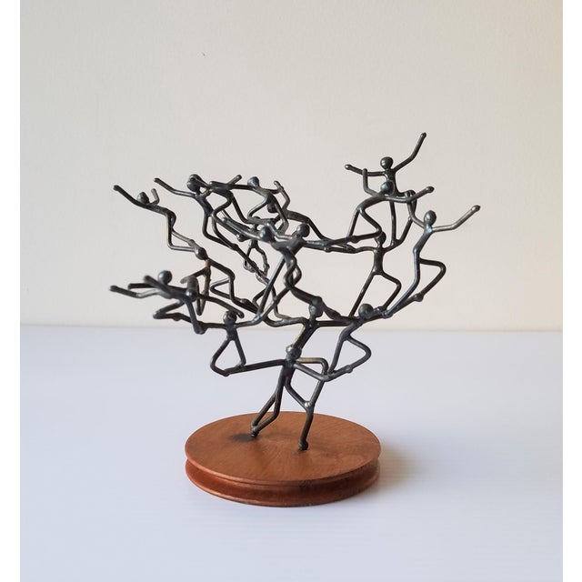 This whimsical piece of art combines abstract figures welded together evoking a whirling motion. Created by Glenn Donovan,...