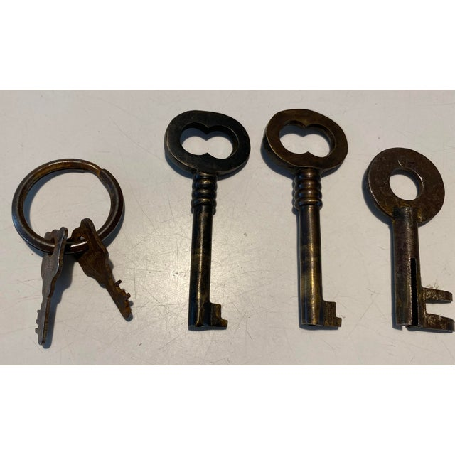 """A nice grouping of antique keys. These range in size from 1"""" to 3""""."""