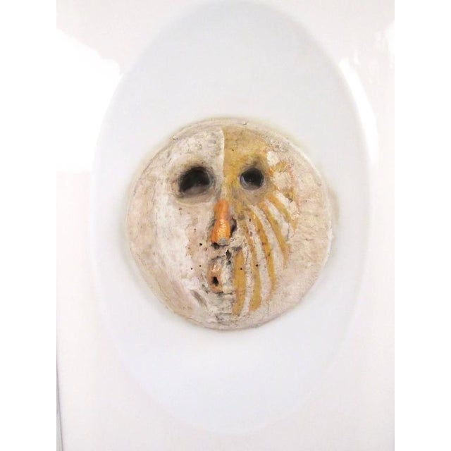 This unique handmade wall sculpture features a unique painted clay form mounted on a unique Lucite style frame. The...
